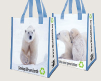 Two polar bear grocery tote bags with blue handles