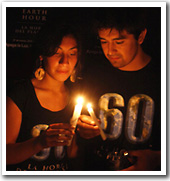 Volunteers lighting candles during Earth Hour celebrations